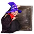 Witch little girl holding  book. - Foto Stock