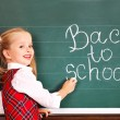 Child writting on blackboard. - Foto Stock