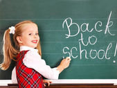Child writting on blackboard. — Stock Photo