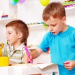 Children painting  in kindergarten. - Foto Stock