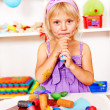 Child playing plasticine. - Foto Stock