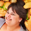 Woman with fast food. - Stock Photo
