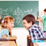 School child writting on blackboard. — Stock Photo #12802929