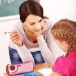 Stock Photo: School child with teacher.