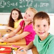 School child sitting in classroom. — Stock Photo #12803133