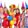 Stock Photo: Birthday party group of teen with clown.