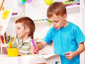 Children painting in kindergarten. — Stock Photo