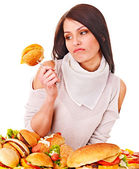Woman holding hamburger. — Stock Photo