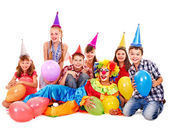Birthday party group of teen with clown. — Stock Photo
