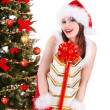 Christmas girl in santa hat holding stack gift box. — Stock Photo #12810850