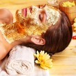 Woman getting  facial mask . - Stock Photo