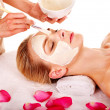 Clay facial mask in beauty spa. - Stock Photo