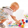 Child painting by finger paint. - Photo