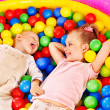 Kids in colored ball. - Photo