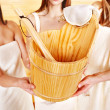 Sauna bucket  holding by group woman. - Photo