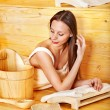 Woman with sauna equipment. - Photo