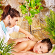Woman getting massage in spa. - Photo
