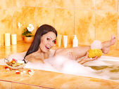Woman take water bath. — Stock Photo