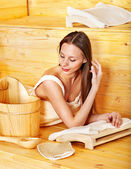 Woman with sauna equipment. — Stock Photo
