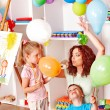 Child playing with balloon. - Stock Photo