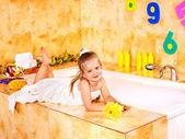 Child washing in bubble bath . — Stock Photo