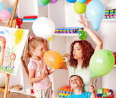 Child playing with balloon. — Stock Photo