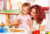 Child painting with mum. — Stock Photo