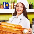 Female chef holding  food. - Stock Photo