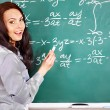 Stock Photo: Schoolchild writing on blackboard.