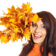 Woman holding orange leaves. — Stock Photo