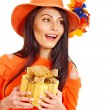Stock Photo: Woman holding gift box .