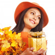 Woman holding autumn gift box . — Stock Photo