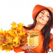 Woman holding autumn gift box . — Stock Photo #13092159