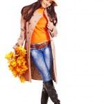 Woman holding orange leaves. — Stock Photo #13093352