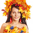 Girl with a wreath of autumn leaves on the head. — Stock Photo #13093601