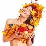 Girl holding basket with fruit. — Stock Photo #13093715