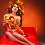 Girl holding basket with fruit. — Stock Photo #13094037