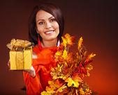 Woman holding gift box. — Stock Photo