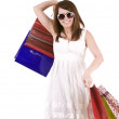 Girl in glasses with gift bag shopping. — Stock Photo #1336049