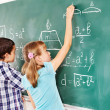 School child writting on blackboard. — Stock Photo #13336281