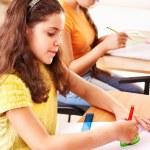 School child sitting in classroom. — Stock Photo #13336284