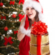 Christmas girl in santa holding stack gift box. — Stock Photo