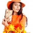 Woman holding orange leaf and handbag. — Stock Photo