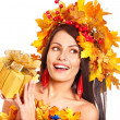 Girl with a wreath of autumn leaves on the head. — Stock Photo