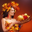 Girl holding basket with fruit. — Stock Photo #13336632