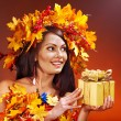 Girl with a wreath of autumn leaves on the head. — Stock Photo #13336633