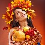 Girl holding basket with fruit. — Stock Photo #13336634