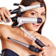 Woman holding iron curling hair. — Stock Photo #13336637