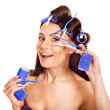 Woman wear hair curlers on head. — Stock Photo #13336638