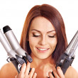 Woman holding iron curling hair. — Stock Photo #13336640